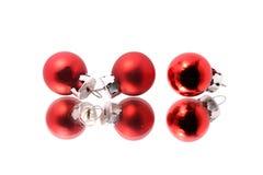 Tres bolas duplicadas de la Navidad Foto de archivo libre de regalías