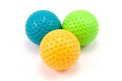 Tres bolas plásticas coloreadas Foto de archivo libre de regalías