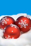 Tres bolas rojas de la Navidad Imagen de archivo libre de regalías