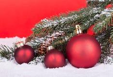 Tres bolas rojas de la Navidad Foto de archivo libre de regalías