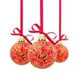 Tres bolas rojas de la Navidad en una fila Imagen de archivo libre de regalías