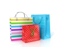 Tres bolsas de papel coloridas para hacer compras Fotografía de archivo libre de regalías