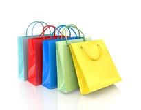 Tres bolsas de papel coloridas para hacer compras Fotos de archivo libres de regalías