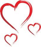 Tres bosquejaron corazones Fotografía de archivo