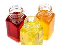 Tres botellas con aceites Fotografía de archivo libre de regalías