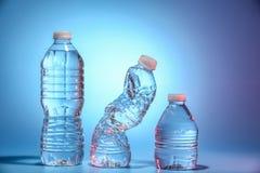 Tres botellas de agua Foto de archivo libre de regalías