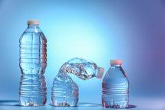 Tres botellas de agua Fotos de archivo libres de regalías