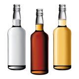 Tres botellas de bebidas del alcohol Imágenes de archivo libres de regalías