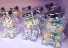 Tres botellas de caramelos Fotos de archivo