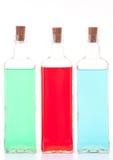 Tres botellas de cristal Imagenes de archivo