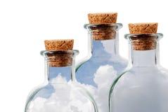 Tres botellas de cristal Imagen de archivo libre de regalías