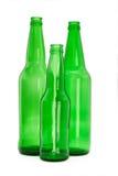 Tres botellas de cristal verdes Fotos de archivo libres de regalías