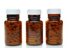 Tres botellas de la medicina de Brown Imágenes de archivo libres de regalías