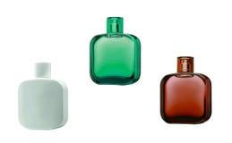Tres botellas de perfume con reflexiones Imagen de archivo libre de regalías
