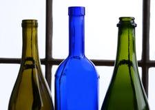 Tres botellas de vino vacías Fotos de archivo libres de regalías