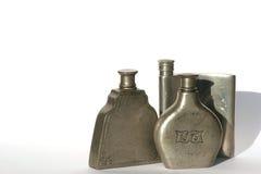 Tres botellas del estaño Fotografía de archivo libre de regalías