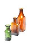 Tres botellas en línea Imagen de archivo libre de regalías