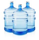Tres botellas grandes de agua aisladas en el fondo blanco Fotografía de archivo
