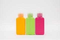 Tres botellas plásticas de sustancias químicas de hogar Fotografía de archivo libre de regalías