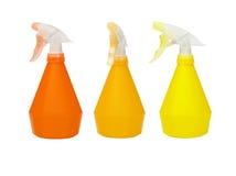 Tres botellas plásticas del aerosol Imagen de archivo