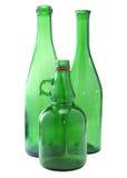Tres botellas verdes Imágenes de archivo libres de regalías