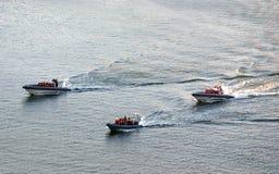 Tres botes de salvamento en el mar Imágenes de archivo libres de regalías