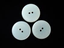 Tres botones blancos redondos Fotos de archivo libres de regalías