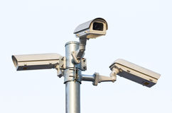 Tres cámaras de seguridad. Fotos de archivo libres de regalías