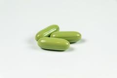 Tres cápsulas de gelatina suaves verdes claras Imagen de archivo libre de regalías