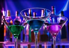 Tres cócteles en los vidrios de martini Fotografía de archivo