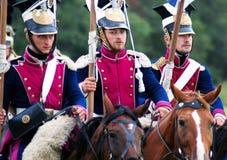 Tres caballos de montar a caballo de los soldados. Fotos de archivo libres de regalías