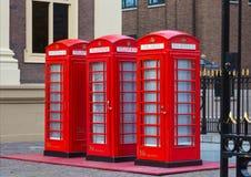 Tres cabinas de teléfonos rojas Imágenes de archivo libres de regalías