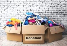 Tres cajas de la donación en sitio fotos de archivo