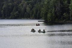 Tres canoas que dirigen hacia fuera Imagenes de archivo