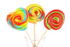 Tres caramelos coloridos aislados Fotografía de archivo