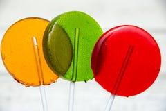 Tres caramelos en los palillos fotografía de archivo