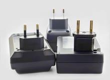 Tres cargadores de batería Fotos de archivo libres de regalías