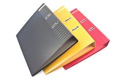 Tres carpetas coloridas de la oficina Foto de archivo libre de regalías