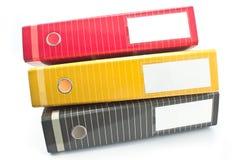 Tres carpetas coloridas de la oficina Imagen de archivo