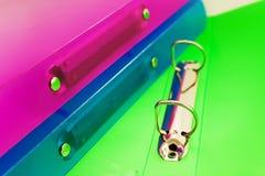 Tres carpetas multicoloras Imagen de archivo libre de regalías
