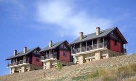 Tres casas de las vacaciones Imagen de archivo libre de regalías