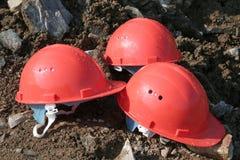 Tres cascos de la defensiva de la montaña Fotografía de archivo