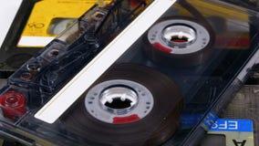 Tres casetes de audio del vintage giran en el fondo blanco almacen de video