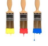 Tres cepillos de pintura Imagenes de archivo