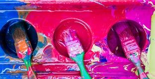 Tres cepillos de pintura Fotos de archivo libres de regalías
