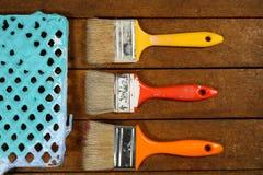 Tres cepillos de pintura Fotografía de archivo libre de regalías