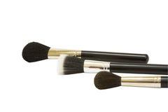Tres cepillos del maquillaje Imagenes de archivo
