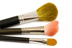 Tres cepillos del maquillaje imagen de archivo