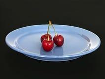 Tres cerezas dulces Foto de archivo libre de regalías