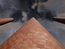 Tres chimeneas Billowing con el cielo oscuro de la tormenta fotografía de archivo libre de regalías